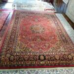 Esfahani Persian Rug Gallery  ORIGIN: IRAN/ STYLE: MASHHAD / DESIGN: MEDALION  PILE: WOOL / FOUNDATION: COTTON  LENGTH FT: 10.01/ WIDTH FT: 6.73/ SQF: 67.30  LENGTH M: 3.05 / WIDTH M: 2.05/ SQM: 6.25  APPROX AGE: OVER 20 YEARS NEW/ APPROX KPSI: 150  INVENT # 1095