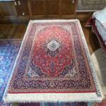 Esfahani Persian Rug Gallery  ORIGIN: IRAN/ STYLE: KASHAN / DESIGN: MEDALION  PILE: WOOL / FOUNDATION: COTTON  LENGTH FT: 7.55/ WIDTH FT: 4.59/ SQF: 34.66  LENGTH M: 2.30 / WIDTH M: 1.40/ SQM: 3.22  APPROX AGE: OVER 15 YEARS / APPROX KPSI: 150  INVENT # 1012