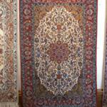 Esfahani Persian Rug Gallery  ORIGIN: IRAN/ STYLE: ISFAHAN / DESIGN: MEDALION  PILE: SILK & FINE WOOL 	/ FOUNDATION: SILK  LENGTH FT: 5.71/ WIDTH FT: 3.71/ SQF: 21.16  LENGTH M: 1.74 / WIDTH M: 1.13/ SQM: 1.97  APPROX AGE: OVER 20 YEARS NEW/ APPROX KPSI: 350  INVENT # 1015