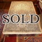 Esfahani Persian Rug Gallery  ORIGIN: IRAN/ STYLE: KASHAN/ DESIGN: MEDALION  PILE: WOOL/ FOUNDATION: COTTON  LENGTH FT: 8.14/ WIDTH FT: 5.18/ SQF: 42.18  LENGTH M: 2.48 / WIDTH M: 1.58/ SQM: 3.92  APPROX AGE: OVER 25 YEARS/ APPROX KPSI: 250  INVENT # 1034