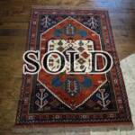 Esfahani Persian Rug Gallery  ORIGIN: IRAN/ STYLE: GHUCHAN/ DESIGN: TRIBAL  PILE: WOOL / FOUNDATION: WOOL  LENGTH FT: 5.61/ WIDTH FT: 4.07/ SQF: 22.82  LENGTH M: 1.71 / WIDTH M: 1.24 SQM: 2.12  APPROX AGE: OVER 25 YEARS / APPROX KPSI: 100  INVENT # 1382