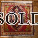 Esfahani Persian Rug Gallery  ORIGIN: IRAN/ STYLE: SHIRAZ/ DESIGN: TRIBAL  PILE: WOOL / FOUNDATION: WOOL  LENGTH FT: 2.10/ WIDTH FT: 2.03/ SQF: 4.27  LENGTH M: 0.64 / WIDTH M: 0.62SQM: 0.40  APPROX AGE: OVER 25 YEARS / APPROX KPSI: 100  INVENT # 1328