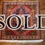 Esfahani Persian Rug Gallery  ORIGIN: IRAN/ STYLE: SHIRAZ/ DESIGN: TRIBAL  PILE: WOOL / FOUNDATION: WOOL  LENGTH FT: 2.10/ WIDTH FT: 2.03/ SQF: 4.27  LENGTH M: 0.64 / WIDTH M: 0.62SQM: 0.40  APPROX AGE: OVER 25 YEARS / APPROX KPSI: 100  INVENT # 1329