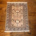 Esfahani Persian Rug Gallery  ORIGIN: IRAN/ STYLE: BALUCHI/ DESIGN: TRIBAL  PILE: WOOL / FOUNDATION: COTTON  LENGTH FT: 2.76/ WIDTH FT: 2.07/ SQF: 5.70  LENGTH M: 0.84 / WIDTH M: 0.63 SQM: 0.53  APPROX AGE: OVER 25 YEARS / APPROX KPSI: 100  INVENT # 1335