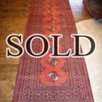 Esfahani Persian Rug Gallery  ORIGIN: IRAN/ STYLE: BALUCHI/ DESIGN: TRIBAL  PILE: WOOL / FOUNDATION: WOOL  LENGTH FT: 9.61/ WIDTH FT: 3.35/ SQF: 32.17  LENGTH M: 2.93 / WIDTH M: 1.02 SQM: 2.99  APPROX AGE: OVER 25 YEARS / APPROX KPSI: 100  INVENT # 1365